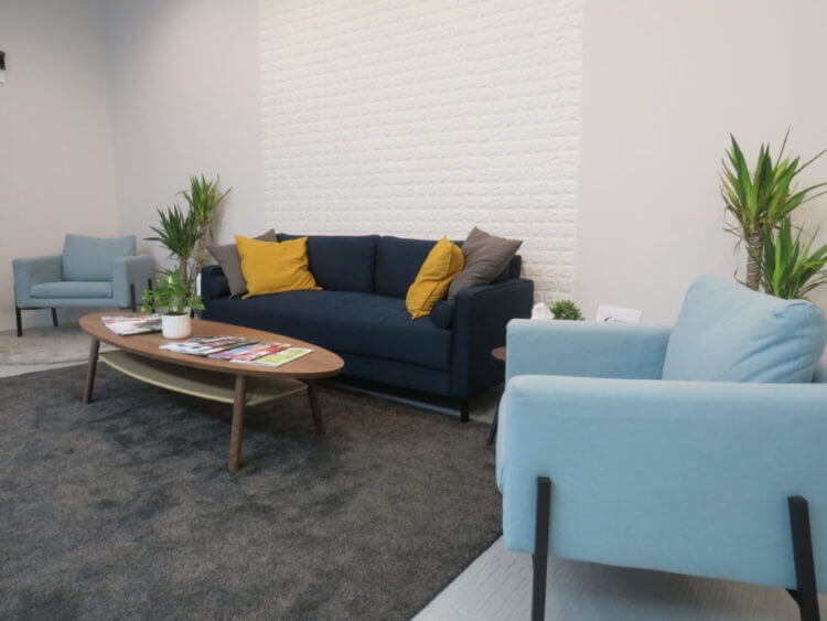 Wide angle shot of the reception couches at Runway Health which is the main seating area.