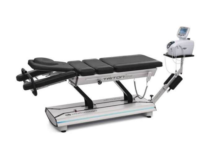 A spinal decompression table which is used to alleviate lower back conditions such as disc herniation, disc bulge, sciatica, pinched nerve, degenerative disc disease, nerve pain, and spinal arthritis and stenosis.